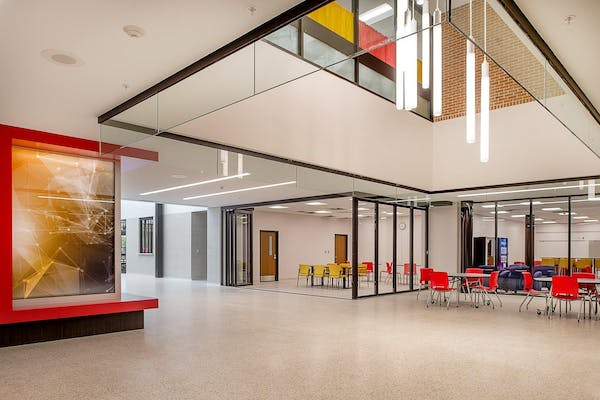 interior acoustic moveable glass walls while allowing maximal transparency and natural daylight to interior spaces
