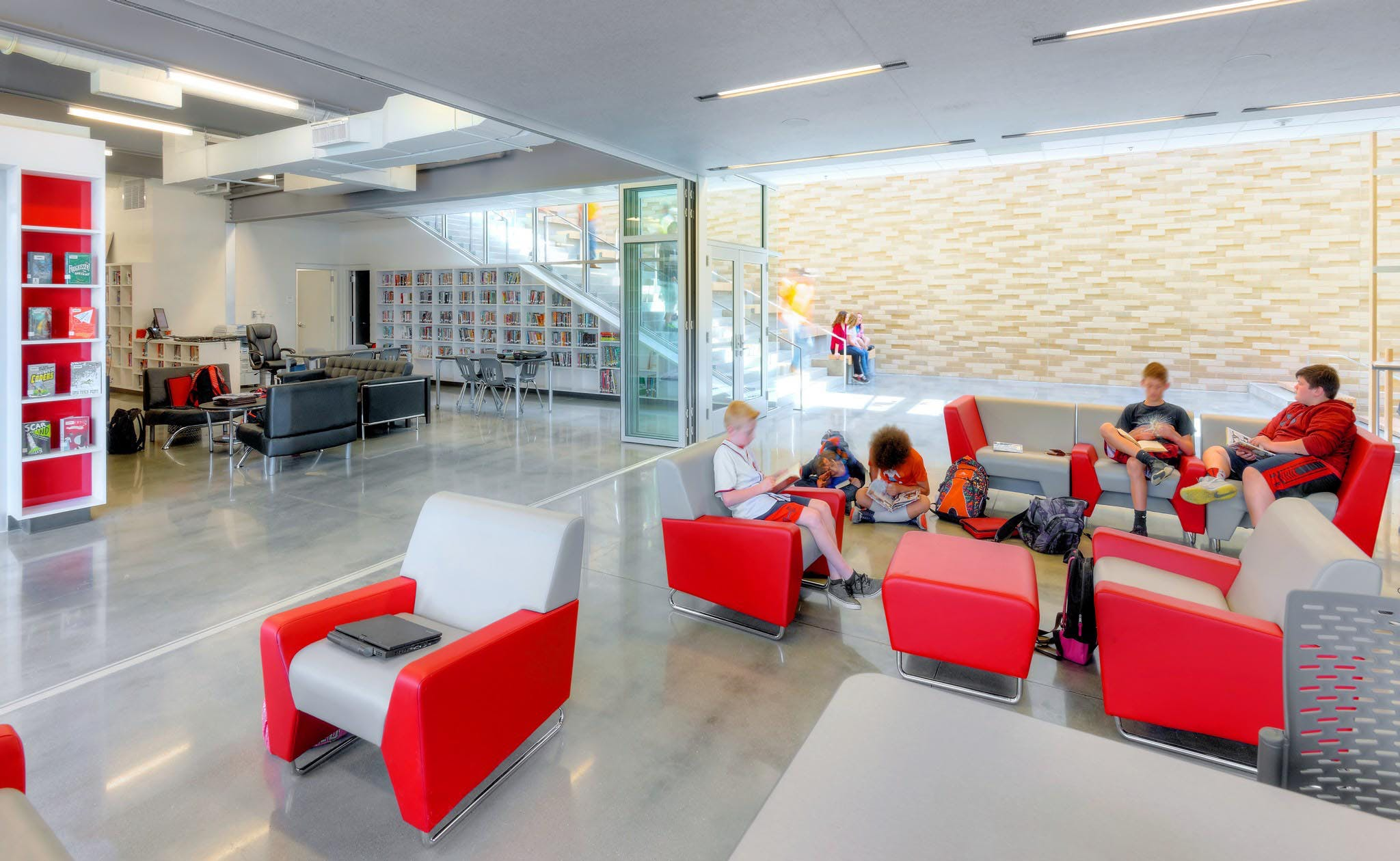 interior glass wall system in school for flexible space and collaboration