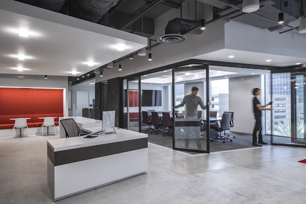 Moveable interior glass walls allowing office tenants to shift room layouts