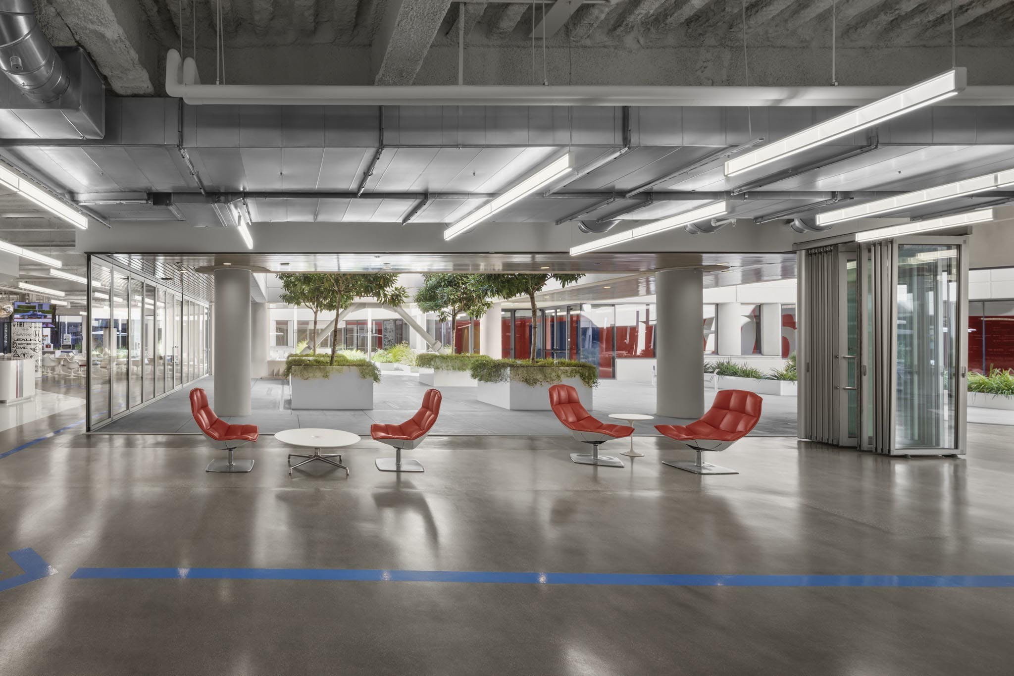 sliding commerical glass wall systems in office exterior for indoor/outdoor connection