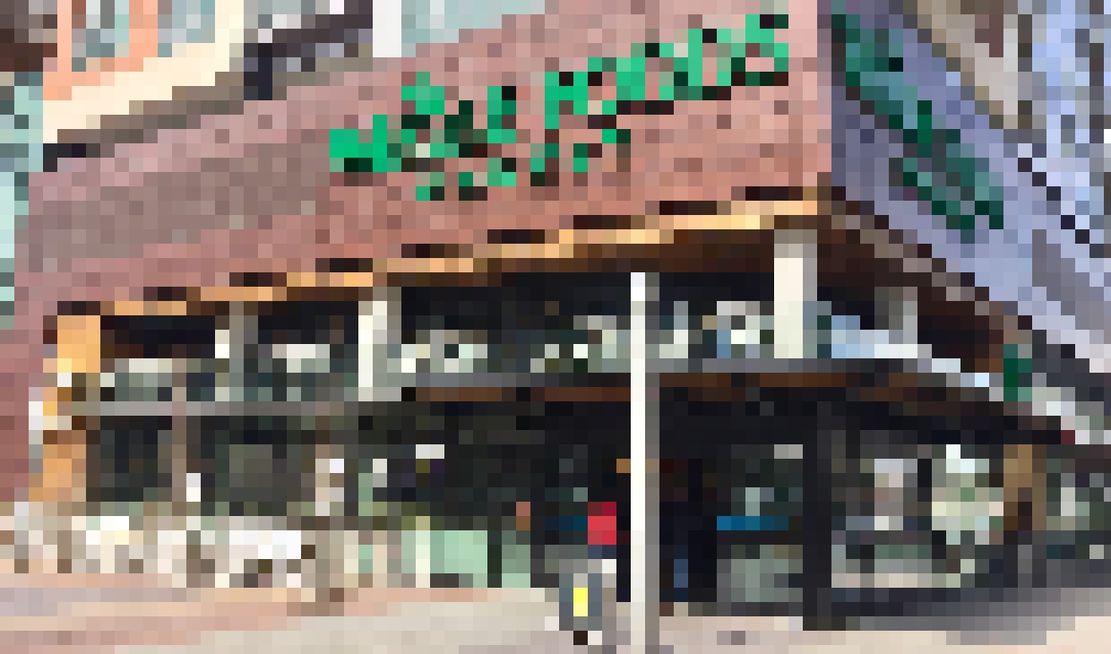 whole foods retail exterior with sliding glass walls