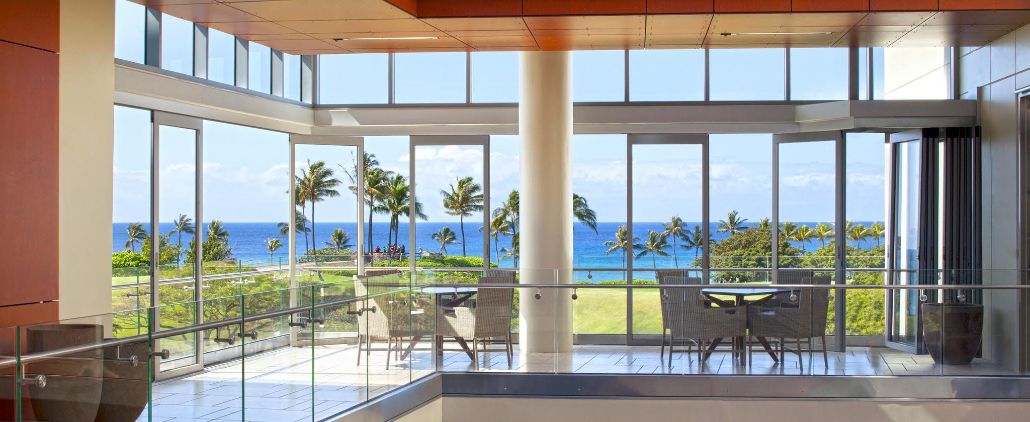 Commercial moveable glass walls - Ocean view floor with multiple opening sliding glass doors