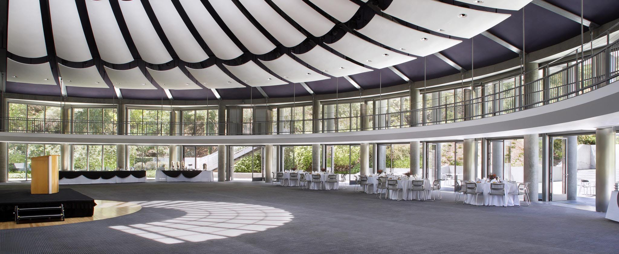 exterior commercial opening glass walls in religious institution for fresh air and daylight