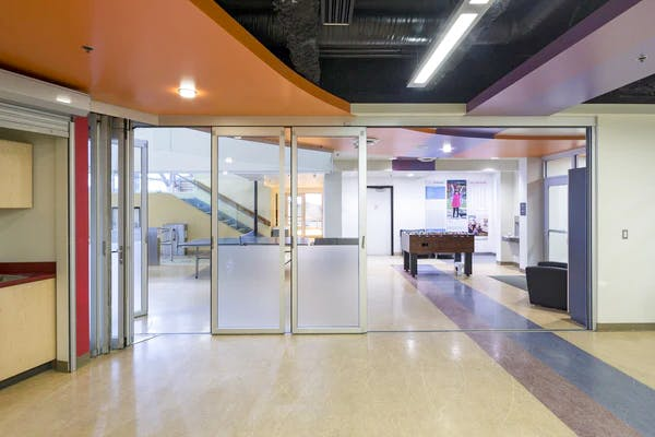 recreation area with moveable interior glass doors used as interior divisions within rooms