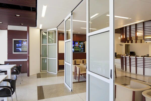dinning area with operable interior glass systems partition used as interior division in health care facility
