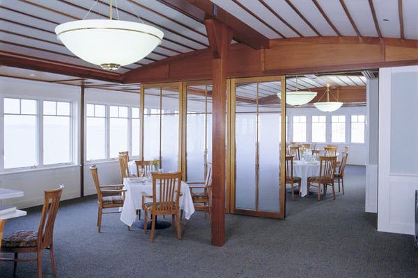dinning area  with wood framed moveable glass wall partitions