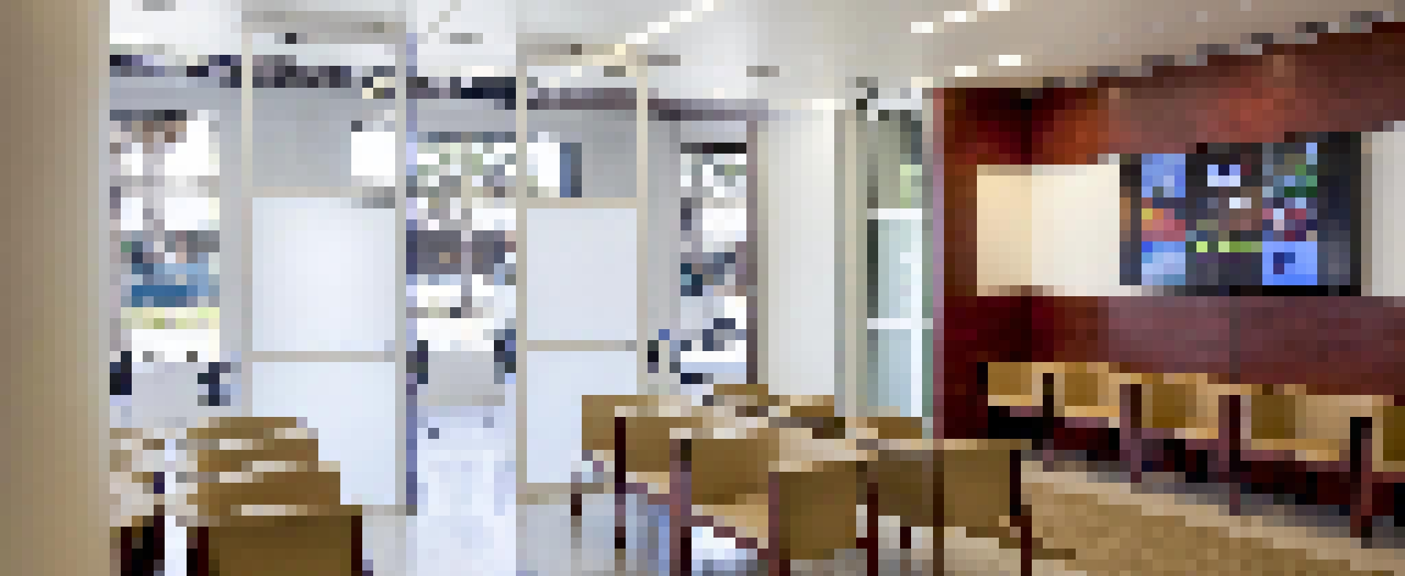 lobby waiting room in health care facility with Operable Interior Glass Systems