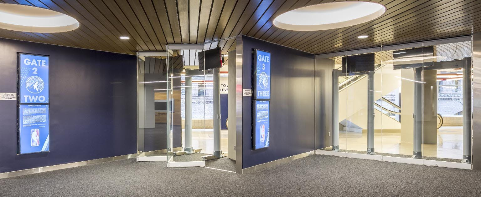 interior glass wall partitions to control traffice flow in sports arena
